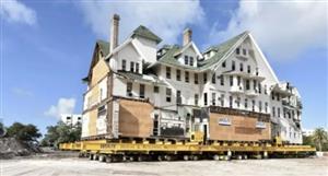 这卡车有60多个轮子,能把整栋大楼打包带走,钉子户怕了!